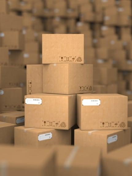 Stacks of Cardboard Boxes, Industrial Background..jpeg
