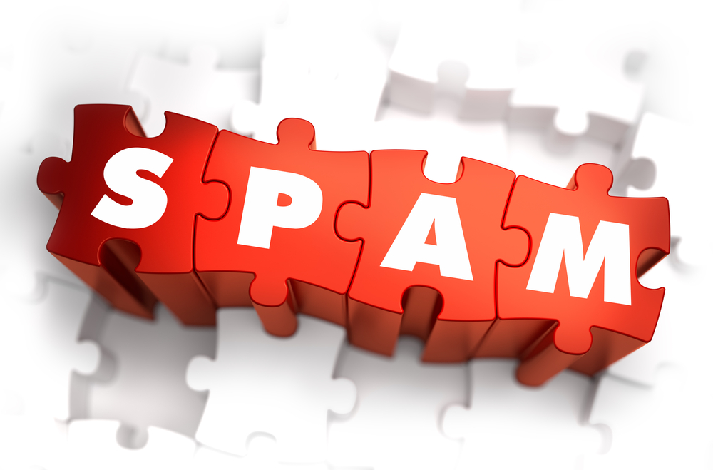 Spam - Text on Red Puzzles with White Background. 3D Render.